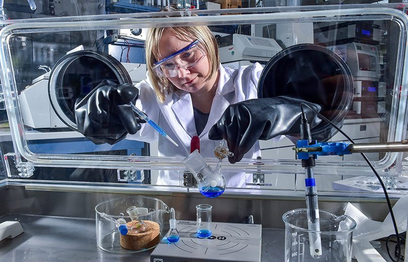 Dr. Doreen Wachner experiments with ionic liquids in a Glovebox.