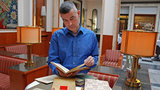 Prof. Christoph Fasbender looks into a book