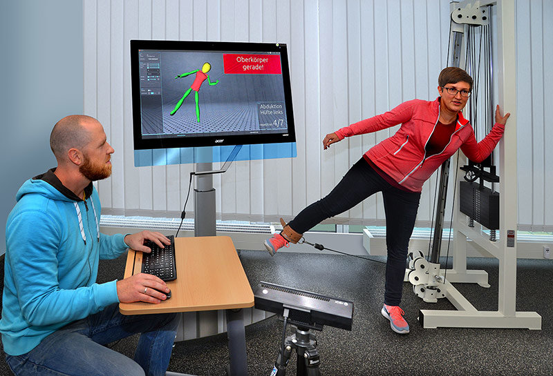 Junior scientist Lars Lehmann and his colleague Julia Richter tests the therapy assistance system