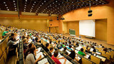 picture of a lecture hall with a lot of students