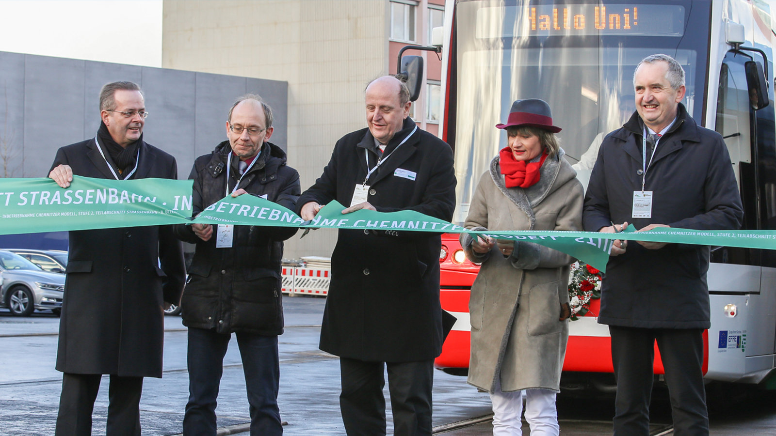 Representatives of State, District, City, and university symbolically cut a green ribbon