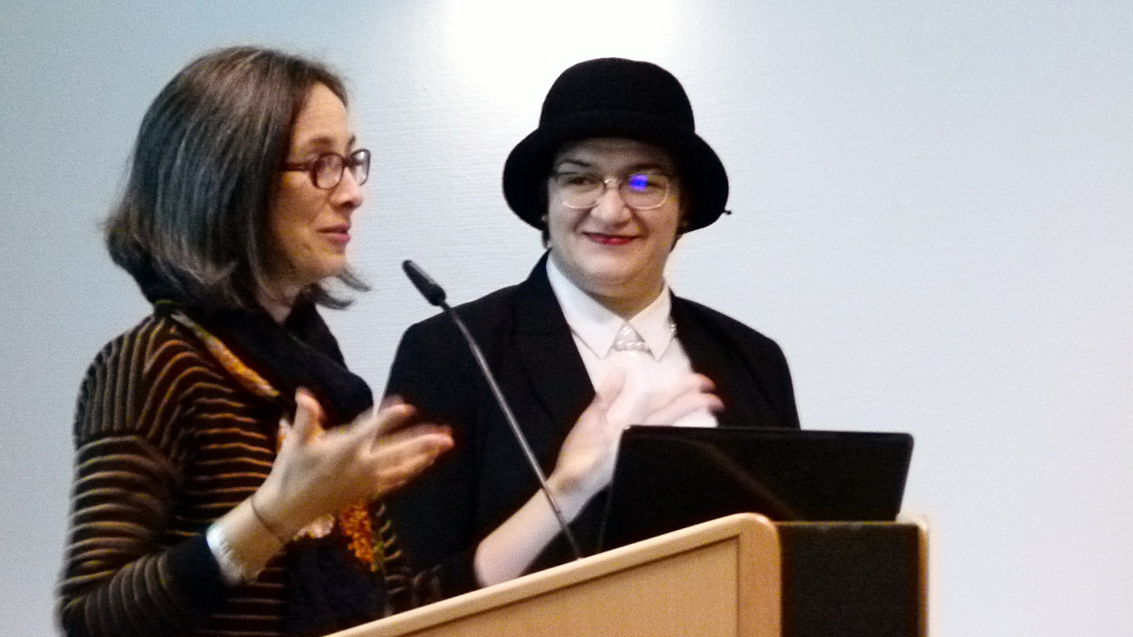 Two Women are standing at a lectern