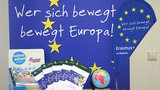 Information material about the ERASMUS program with the flag of the European Union