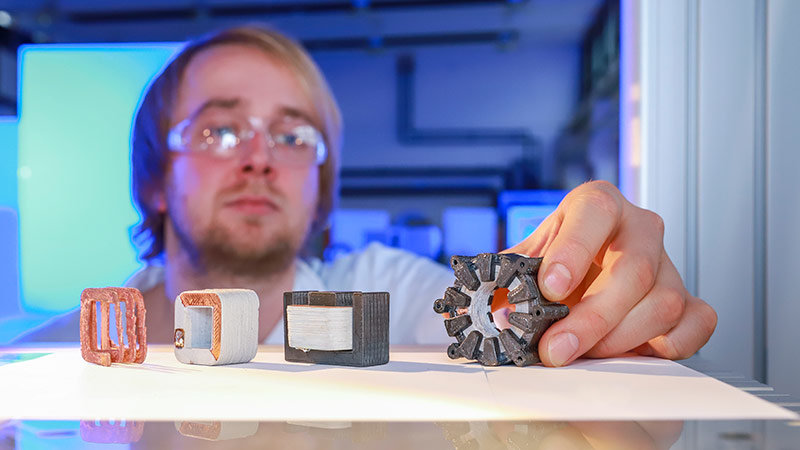 Fabian Lorenz examines the stator of a printed electrical machine