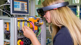Women uses VR glasses in the lab