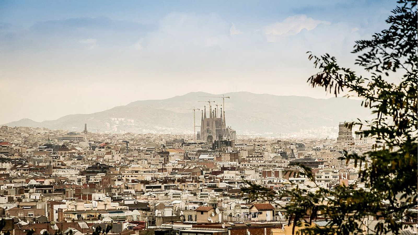 A view over Barcelona with the Sagrada Familia in the center.