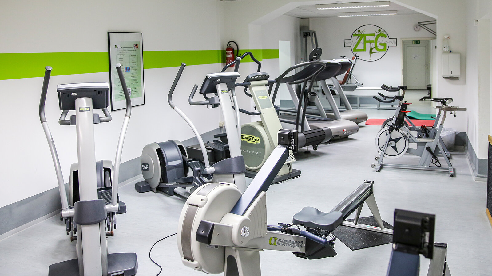 Photo of a fitness studio with different exercise machines.