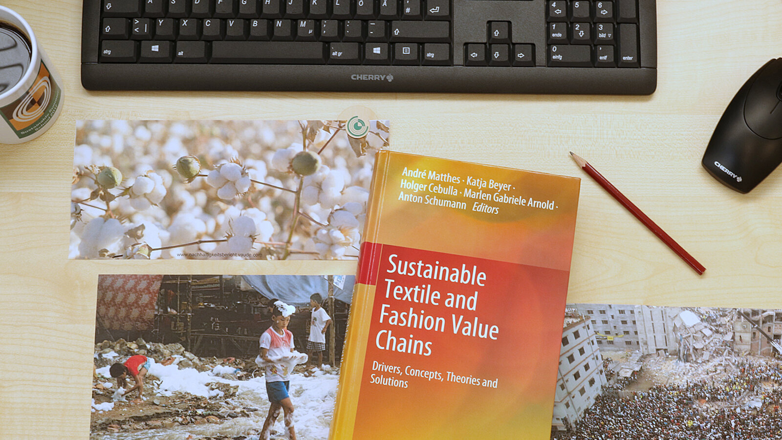 Photo of a desk with the book Sustainable Textile and Fashion Value Chains on it.