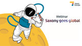 "Graphic of an astronaut on the moon with the caption ""Saxony Goes Global"""